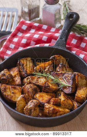 A Pan Of Seasoned Baked Potatoes