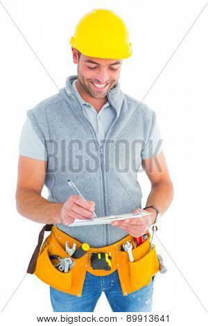Smiling repairman writing on clipboard over white background