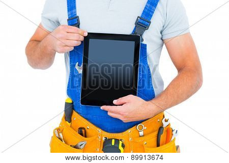 Midsection of repairman holding digital tablet on white background