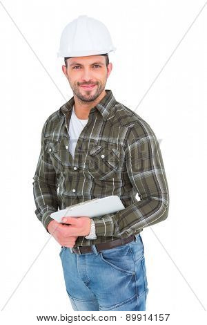 Smiling handyman holding a clipboard over white background