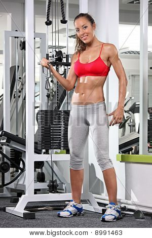 Woman Working Out On A Fitness Equipment At The Gym