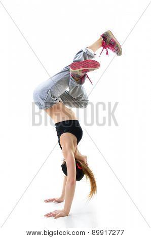 Teen girl hip-hop dancer over white background