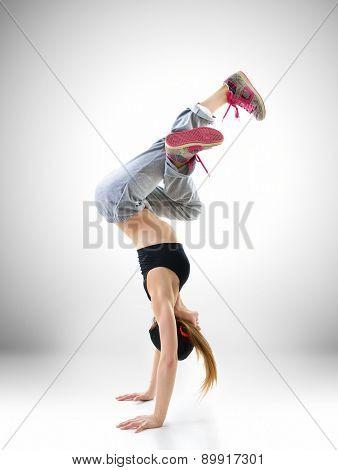 Teen girl hip-hop dancer, studio shot
