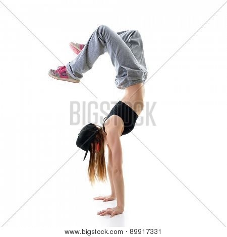 Teen girl hip-hop dancer over white background