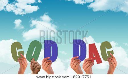 Hands holding up god dag against blue sky
