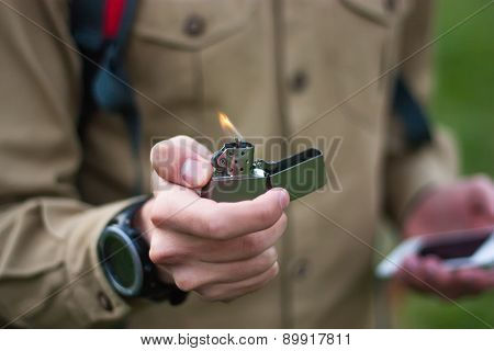 Tourist Using Lighter In The Tour