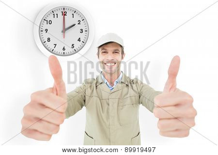 Happy delivery man showing thumbs up against two o clock