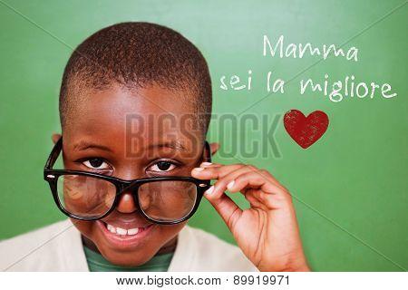 Cute pupil tilting glasses against green