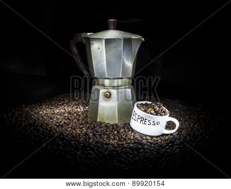 Old Coffeepot With Cup And Coffee Beans