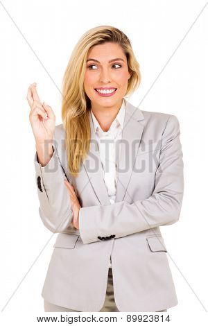 happy businesswoman with fingers crossed isolated on white
