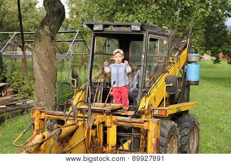Little Boy And An Excavator.