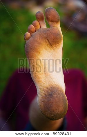 Dirty Foot Man On Green Background.