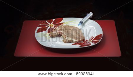 Concept Genetically Modified Organism: Syringe And Meat