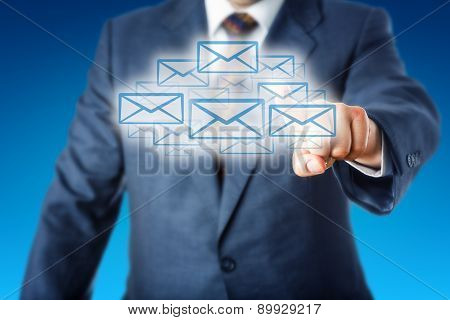 Business Man Touching A Cloud Of Many Email Icons