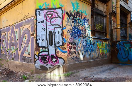 Colorful Abstract Graffiti On Old Yellow Walls