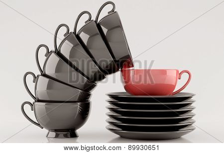 Black cups and saucers on white background