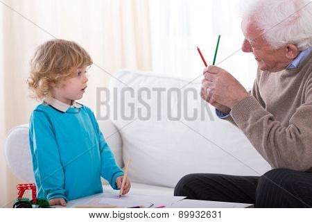 Grandpa Caring About His Grandson