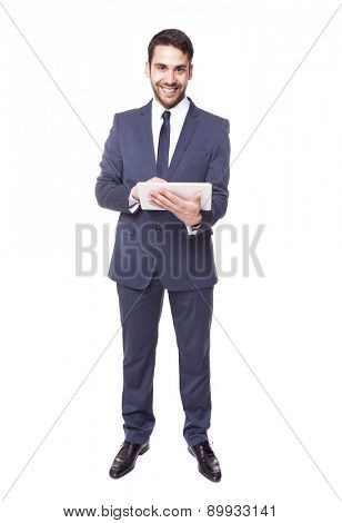 Handsome business man standing with tablet computer, isolated on white background