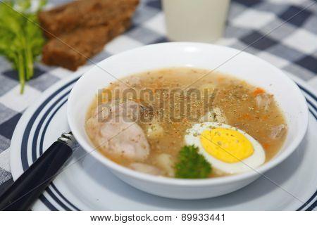 Traditional polish Zurek soup sour-rye