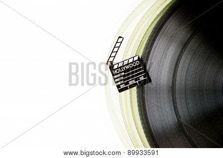 Movie Clapper On 35 Mm Film Roll Isolated