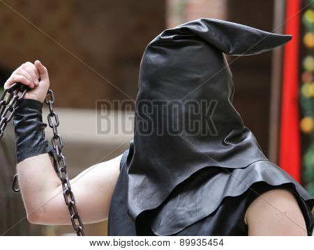 Executioner With Black Hood On His Head And The Chain