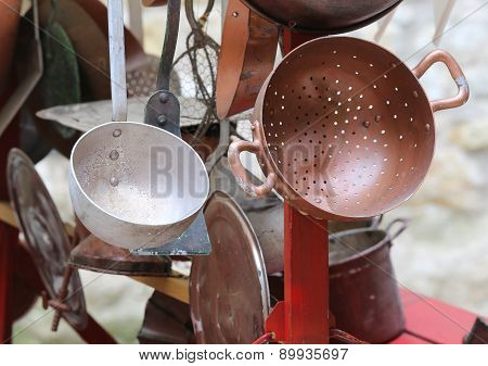 Collander And Other Old Copper Objects In Cart For Sale At Flea Market