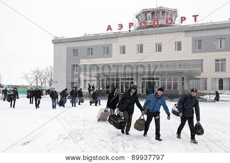 Passengers With Baggage To Background Airport Terminal Petropavlovsk-Kamchatsky. Kamchatka