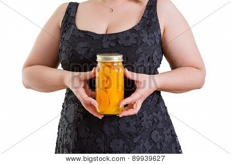 Woman Holding A Jar Of Homemade Peaches