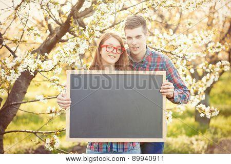 Young Teen Couple With Blackboard