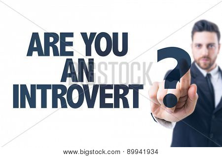 Business man pointing the text: Are You an Introvert?