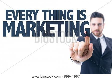 Business man pointing the text: Every Thing is Marketing
