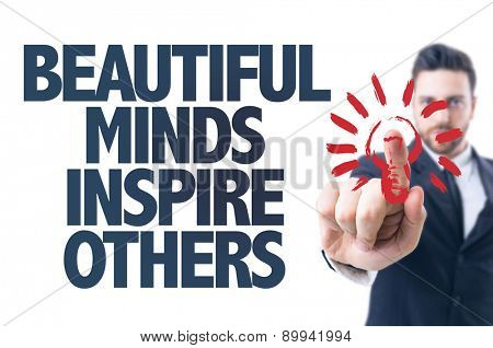 Business man pointing the text: Beautiful Minds Inspire Others