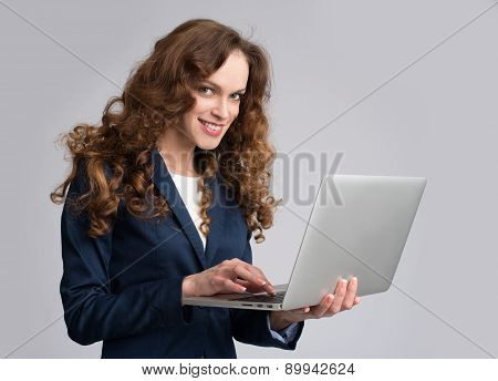 Beautiful Young Woman Holding Laptop