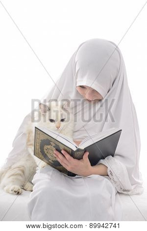 Pretty Muslim Girl And Cat Reading Holy Book Of Quran