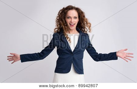 Portrait Of Happy Young Girl With Stretched Arms