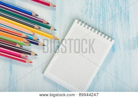 Color Pencils And Notepad