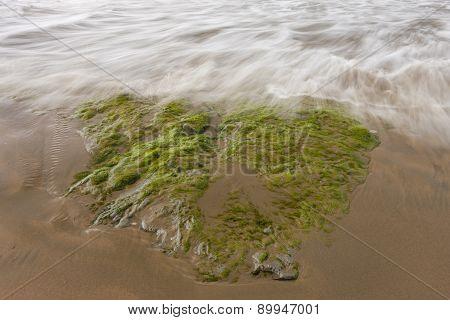 Ocean water over the rock.