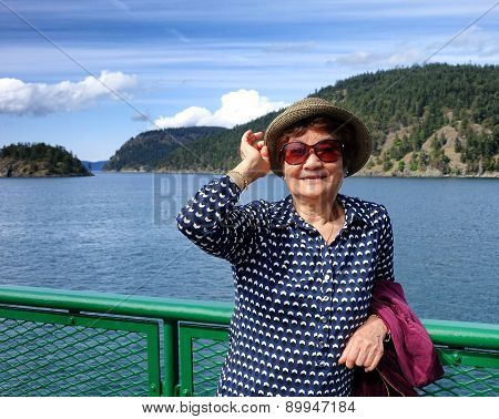 Senior Woman Outdoors Near The Water Front