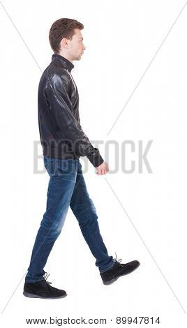 Back view of going  handsome man in jacket.  walking young guy . Rear view people collection.  backside view of person.  Isolated over white background. stylish guy in warm clothes goes to the right.