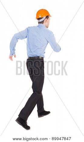 Back view of running engineer in helmet. Walking guy in motion. Rear view people collection. Backside view of person. Isolated over white background. Slim office worker wearing a hard hat running down