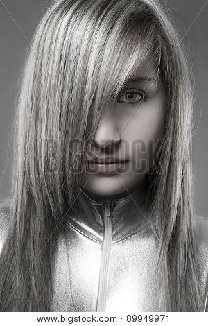 Young attractive future with vacant eyes and silver gray suit