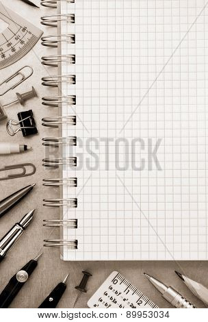 notebook and school accessories at metal background texture