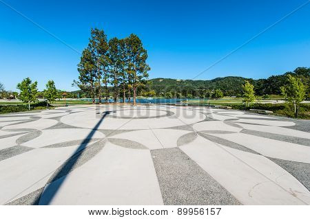 Geometric Patterns In Plaze Next To Lake