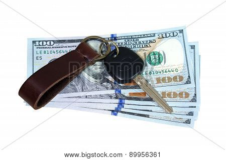 Car Key On Money Isolated On White