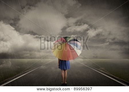 Woman Walking Alone On Rainy Day