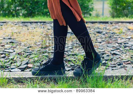 Woman Walking On Gravel