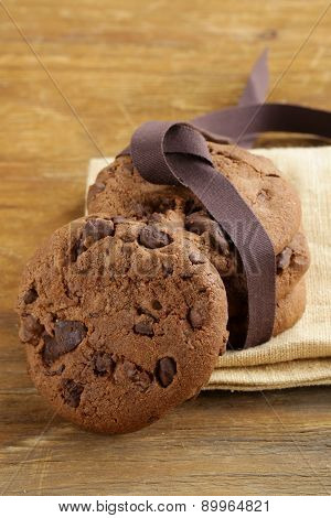 sweet tasty cookies with chocolate chips on the table