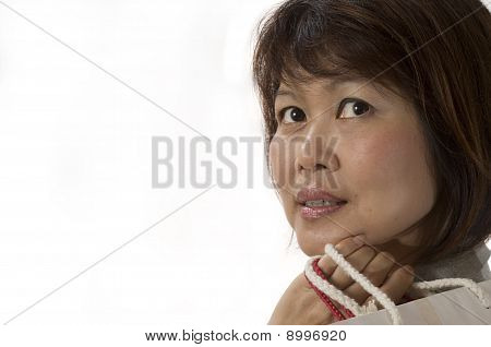 Portrait Of Asian Woman With Shopping Bags