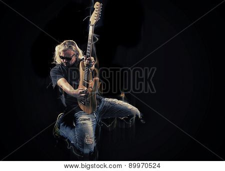 Hard rock heavy metal guitarist playing his instrument