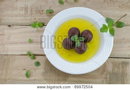 Gulab Jamun With Mint Leaves